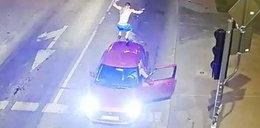 Pijany wbiegł na auto stojące na światłach Zobacz film z monitoringu