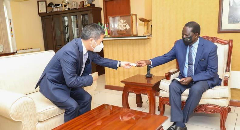 Former Prime Minister Raila Odinga with China's Ambassador to Kenya Zhou Pingjian at his Capitol Hill offices