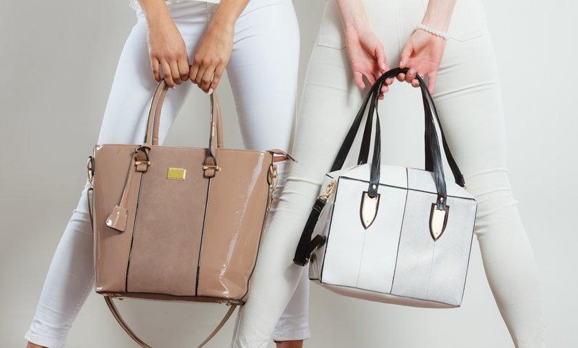 Fashionable girls with bags handbags.