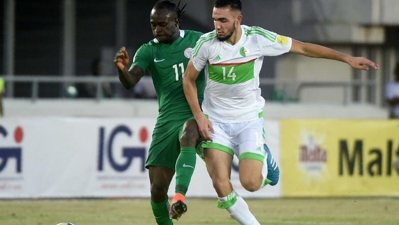 Algeria's midfielder Nabil Bentaleb (R) challenges Nigeria's midfielder Victor Moses during the 2018 FIFA World Cup African zone group B qualifying football match between Nigeria and Algeria at the Akwa Ibom State Stadium in Uyo on November 12, 2016
