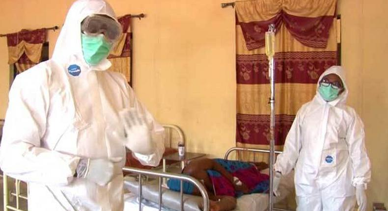 Health workers attending to a Lassa patient