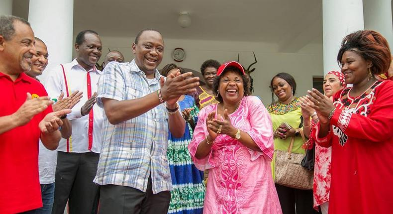 President Uhuru Kenyatta and other leaders welcome Deputy Governor Hazel Katana to the Jubilee Party at State House Mombasa.