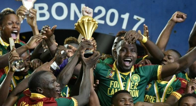 Cameroon's players celebrate with the winner's trophy after defeating Egypt 2-1 to win the 2017 Africa Cup of Nations, at the Stade de l'Amitie Sino-Gabonaise in Libreville, on February 5