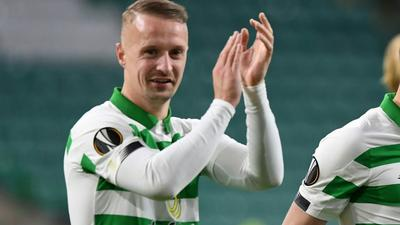 Scotland striker Griffiths charged for kicking smoke bomb at fans