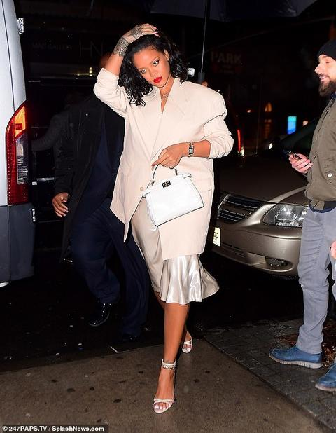 Rihanna steps out in silky skirt and oversized blazer for night out in New York