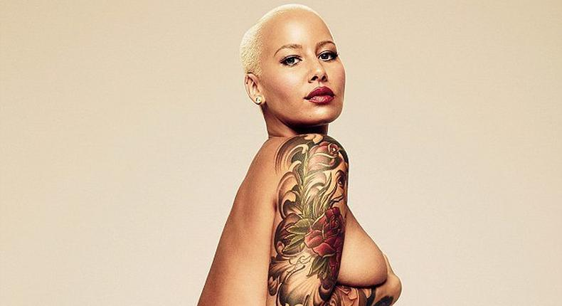 Amber Rose has stripped off naked in a striking image to co-incide with a new interview in GQ magazine, in which she seemed to reignite her feud with the Kardashian-Jenners