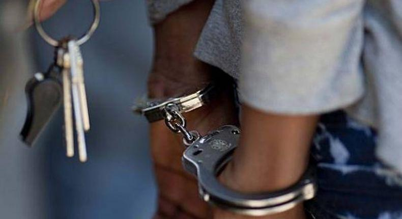 A woman in handcuffs