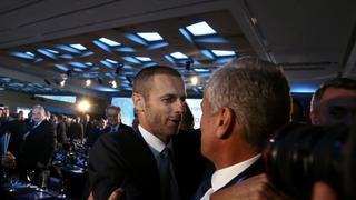 A man congratulates newly elected UEFA President Ceferin of Slovenia during the Extraordinary Congress in Athens