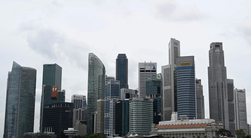 'Dead city': Singapore closes workplaces in virus fight