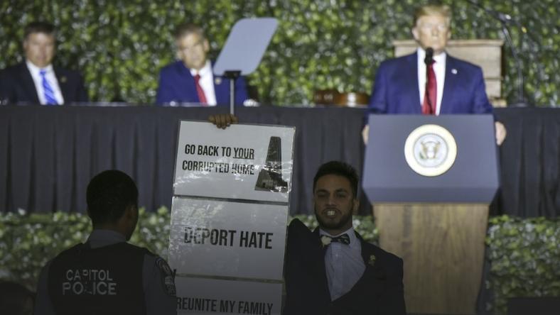 Ibraheem Samirah, a Democratic Virginia assemblyman, protests during US President Donald Trump's speech