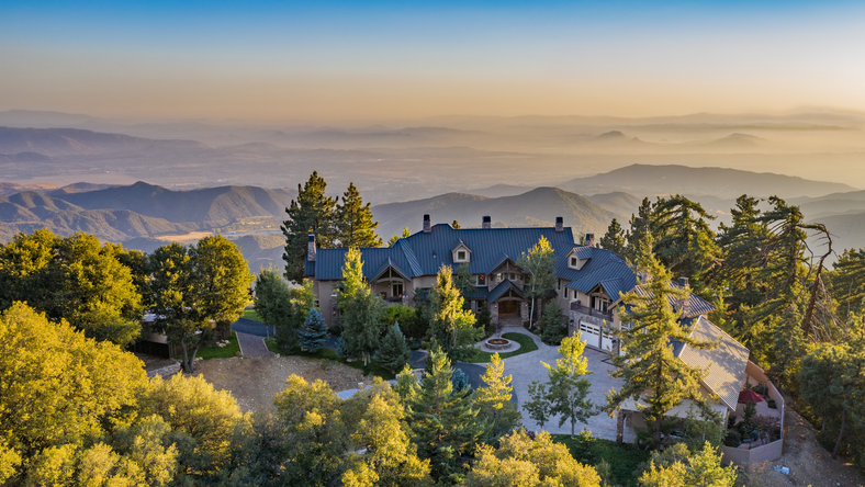 A lottery winner is selling his 16,000-square-foot mountain home that sits on 845 acres on Little San Gorgonio Mountain in Oak Glen, California, for $26 million.