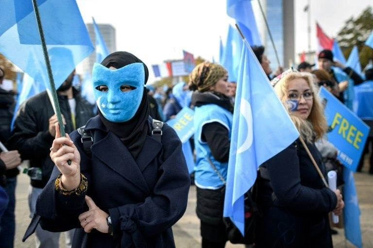 Uighurs demonstrate against China outside the UN offices in Geneva -- a recent UN report said as many as one million ethnic Uighurs are being kept in extrajudicial detention in China's Xinjiang region