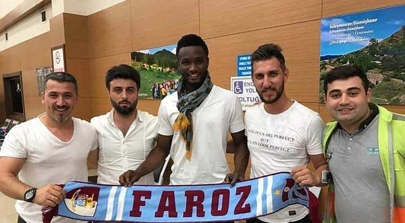 Mikel Obi mobbed by Trabzonspor fans after touching down to join his new club