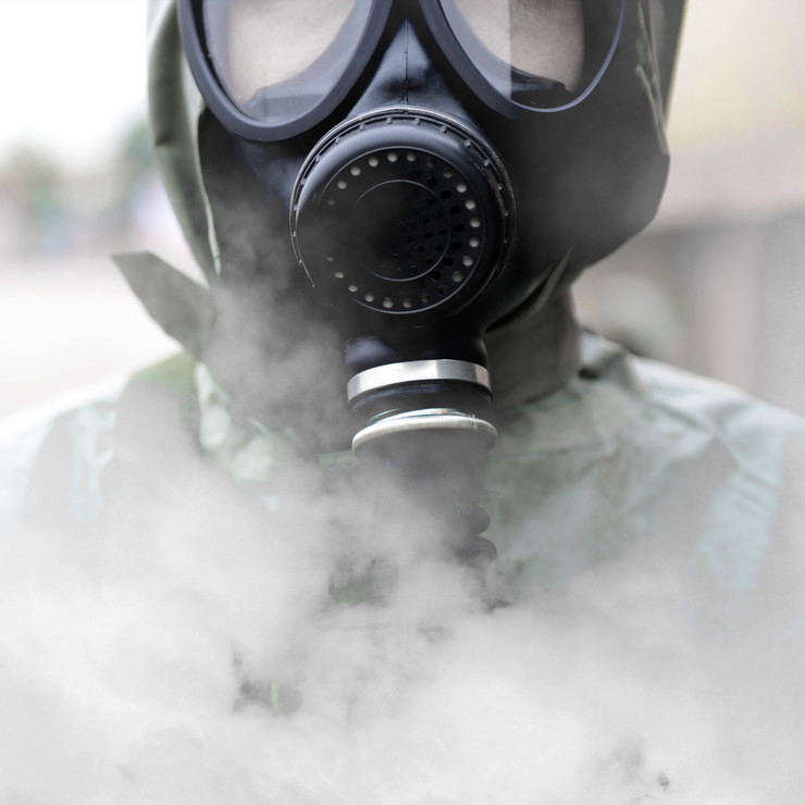stock-photo-a-man-in-a-gas-mask-147158594