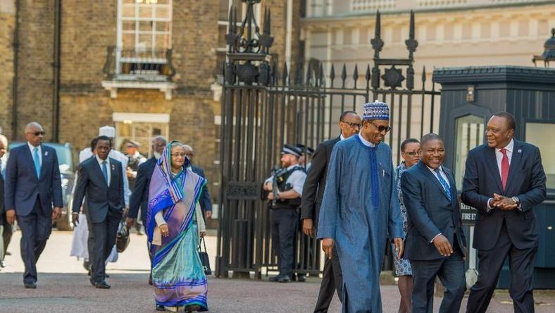 File Photo: President Uhuru Kenyatta with President Muhammadu Buhari of Nigeria and President Filipe Nyusi of Mozambique arriving at St. James's Palace for the official welcome of Commonwealth Heads of Government Meeting in London. PSCU
