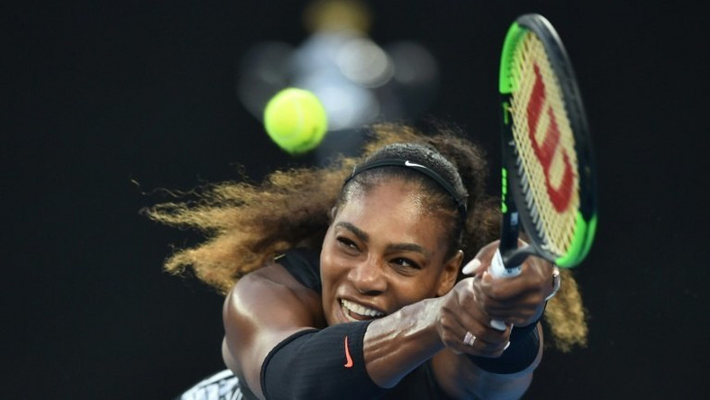 Serena Williams of the US hits a return against Venus Williams of the US during the women's singles final on day 13 of the Australian Open tennis tournament in Melbourne on January 28, 2017