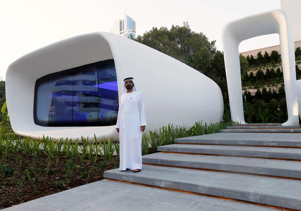 Sheikh Mohammed bin Rashid Al Maktoum stands in front of the world's first functional 3D printed off
