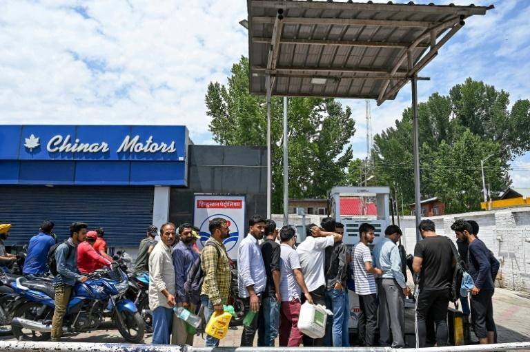 Kashmiri residents, concerned by a security warning, formed long lines outside petrol stations, food stores and bank cash machines