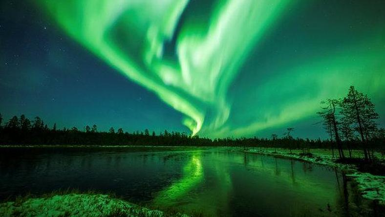 The Northern and Southern Lights are asymmetric dancers in the dark