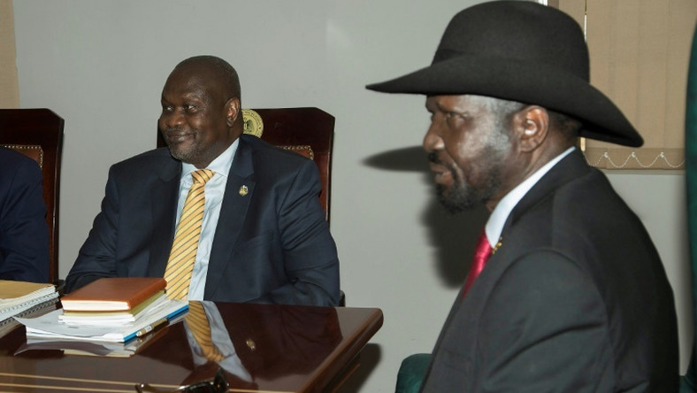 South Sudan rebel leader Riek Machar, left, meets with President Salva Kiir in Juba to try and salvage a peace deal