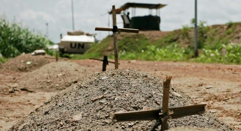 Makeshift graves are seen at the UN House for internally displaced persons in Juba on July 22, 2016