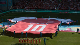 A giant Denmark shirt with Christian Eriksen's name and number was put on display before kick-off Creator: HANNAH MCKAY