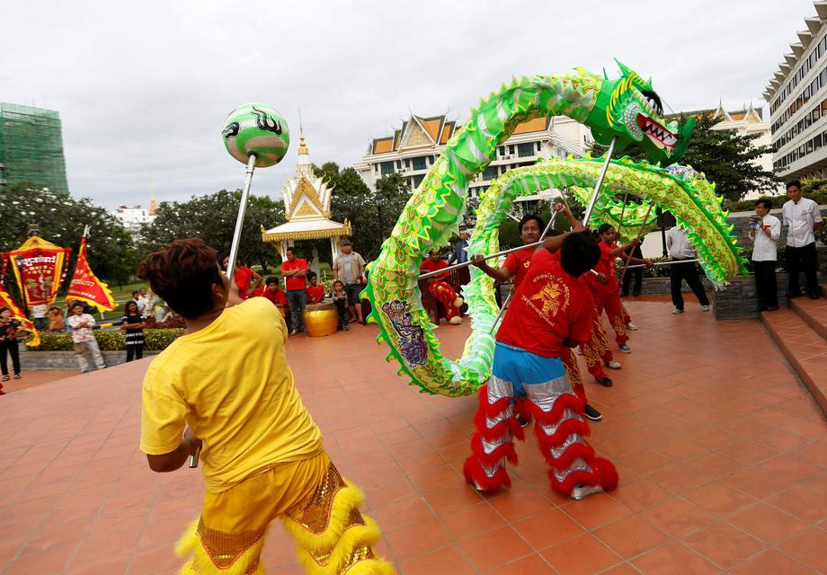 Men perform a lion dance ahead of the Chinese Lunar New Year in Phnom Penh