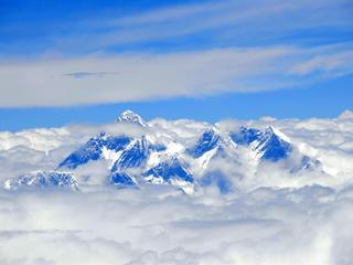 View from above on Mt. Everest surrounded by clouds Tibet China