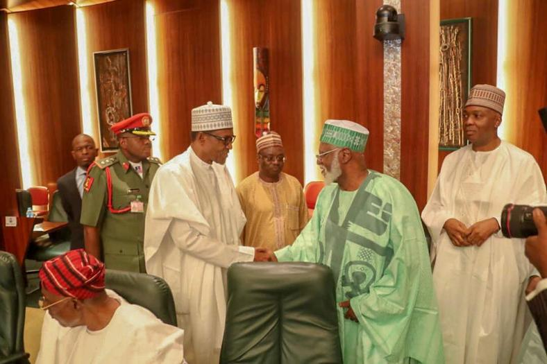 President Muhammadu Buhari shakes hands with former Head of State, Abdulsalami Abubakar, with Senate President, Bukola Saraki in the background at the National Council of State meeting that held in the Presidential Villa on January 22, 2019