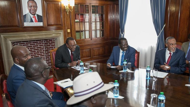 President Uhuru Kenyatta and Raila Odinga at a past meeting with a section of the Building Bridges Initiative team