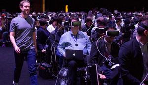 Facebook CEO Mark Zuckerberg (left) walks past a crowd with virtual reality (VR) headsets.