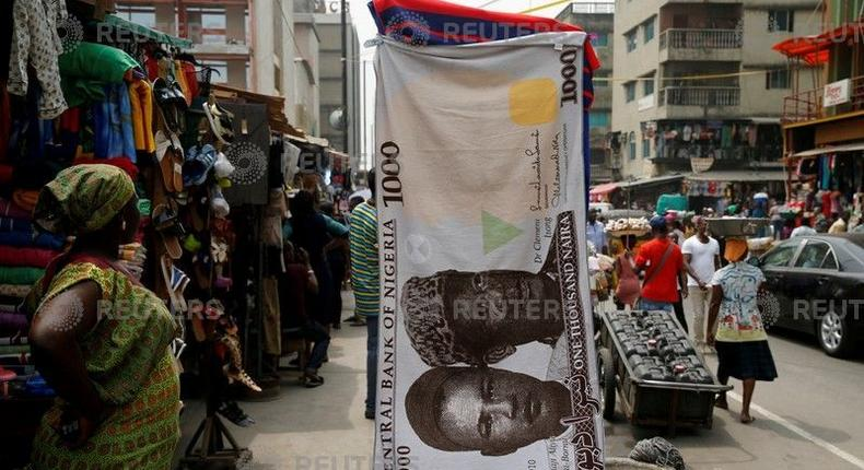A towel with a print of theNigeriannaira is displayed for sale at a streetmarketin the central business district in Nigeria's commercial capital Lagos February 4, 2016.