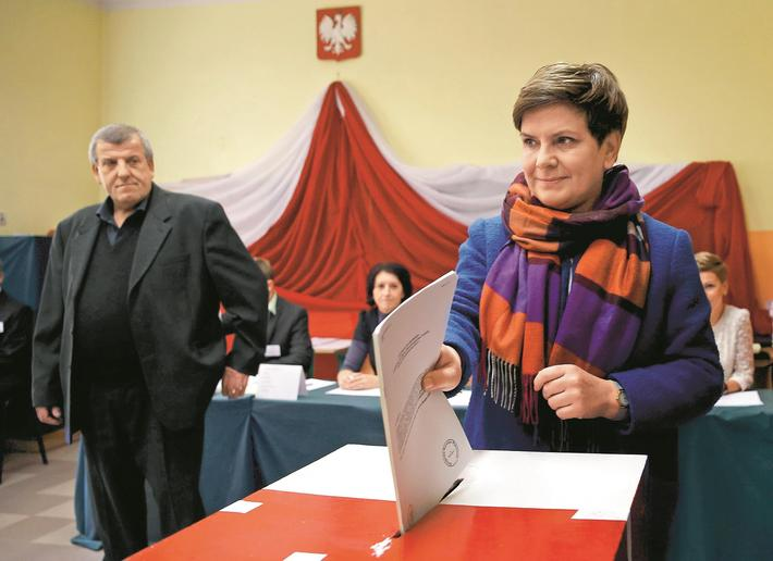 Poland's main opposition party Law and Justice's candidate for prime minister Szydlo casts her ballo