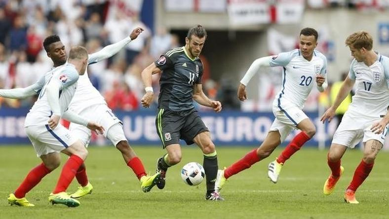 Wales' Gareth Bale in action with England's Wayne Rooney, Daniel Sturridge, Dele Alli, and Eric Dier