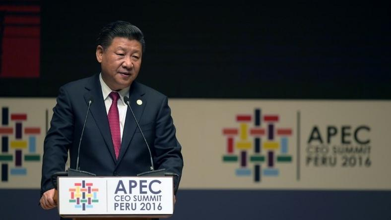 China's President Xi Jinping speaks during a session of the APEC CEO Summit, part of the broader Asia-Pacific Economic Cooperation Summit in Lima on November 19, 2016