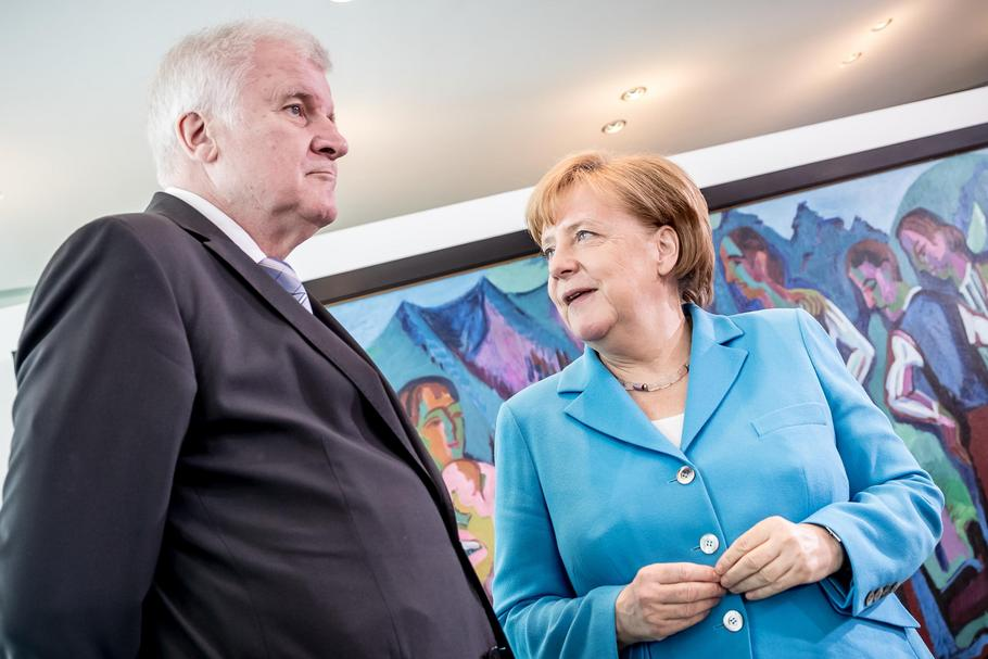 ngela Merkel (Christian Democratic Union - CDU) speaks with interior minister Horst Seehofe
