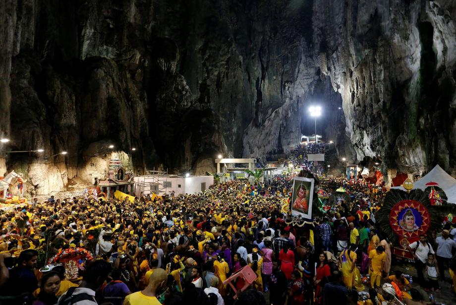 Devotees gather at a shrine in Batu Caves during the Hindu festival of Thaipusam in Kuala Lumpur