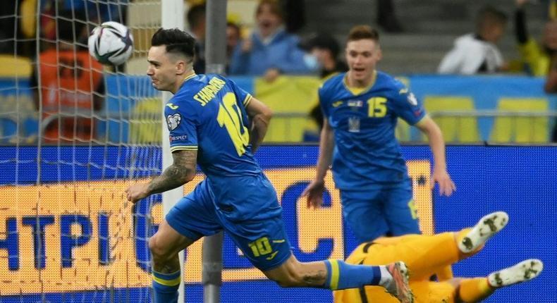 Mykola Shaparenko (L) wheels away in celebration after scoring for Ukraine Creator: FRANCK FIFE