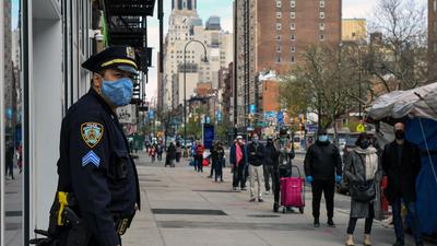 New Role for New York Police: Breaking Up Crowds at Trader Joe's