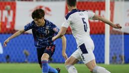 Japan midfielder Kyogo Furuhashi (L) Creator: STR