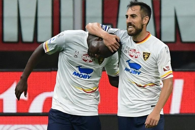 Senegalese forward Khouma Babacar (L) is congratulated by Lecce teammate Marco Mancosu after scoring in a 2-2 Serie A draw at AC Milan