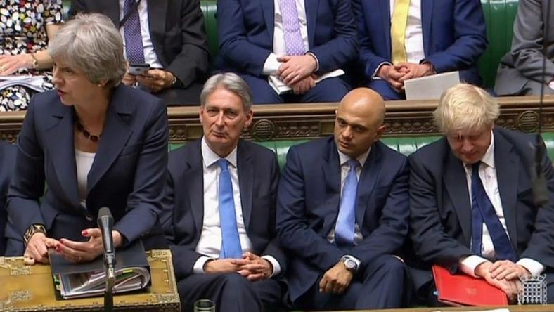 A video grab from footage broadcast by the UK Parliament's Parliamentary Recording Unit shows British Prime Minister Theresa May addressing MPs flanked by pro-Brexit Foreign Secretary Boris Johnson and Chancellor of the Exchequer Philip Hammond who favours close EU ties