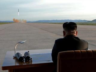 FILE PHOTO: North Korean leader Kim Jong Un watches the launch of a Hwasong-12 missile in this undat