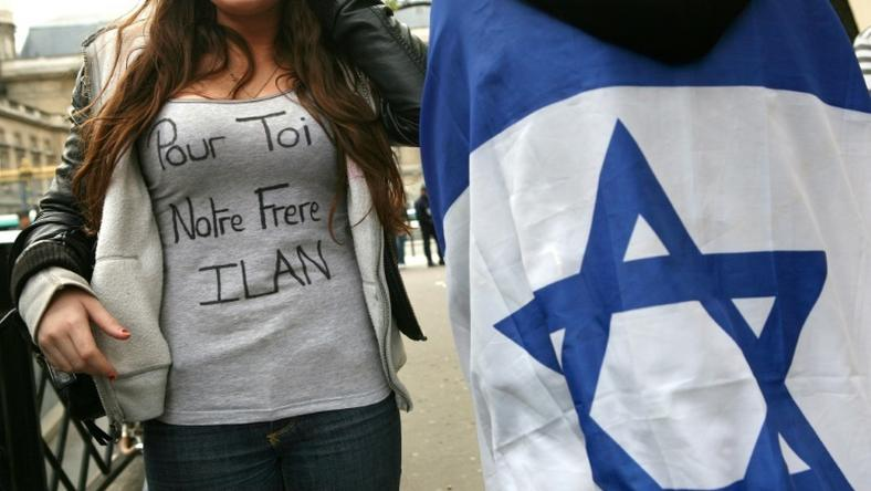"Halimi was tortured for three weeks. The slogan on the woman's T-shirt reads ""For you, our brother Ilan"""