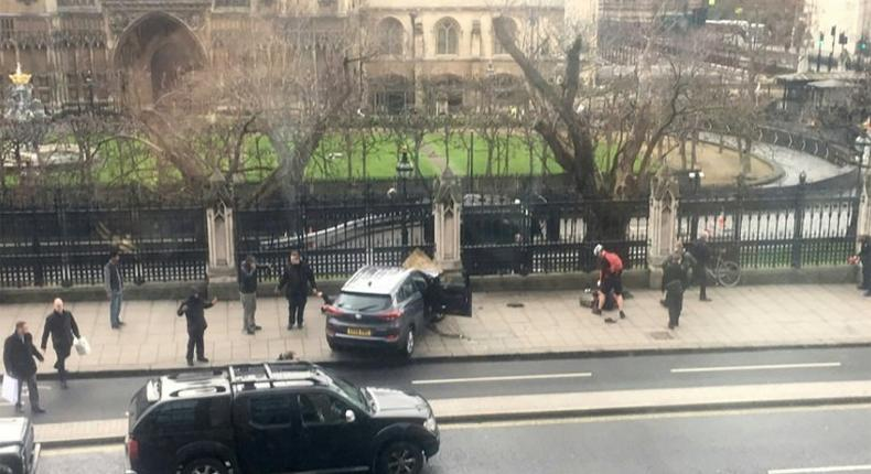 A picture obtained from the Twitter account of James West, shows a car stopped on the sidewalk in front of the Palace of Westminster which houses the Houses of Parliament in central London on March 22, 2017 during an incident