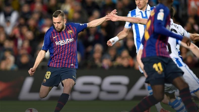 Jordi Alba's goal gave Barcelona a 2-1 win over Real Sociedad on Saturday