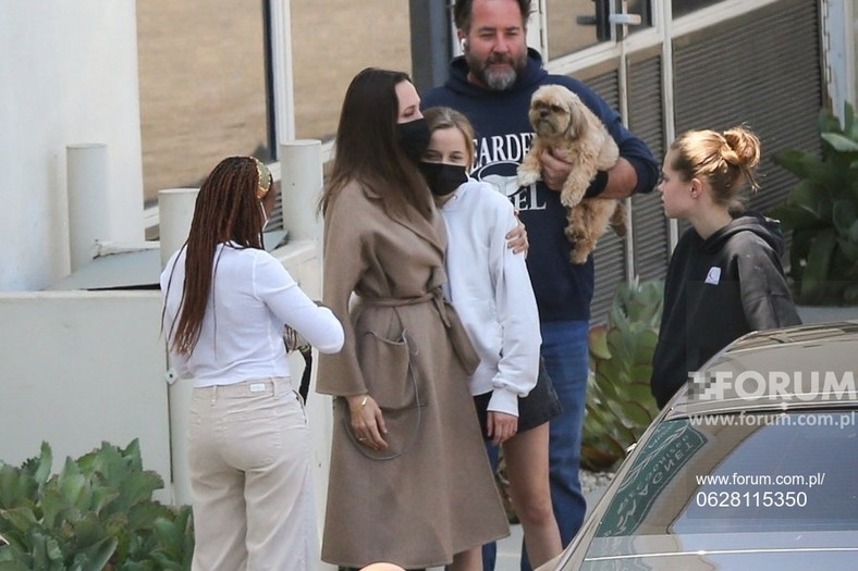 Angelina Jolie hugs her daughters after leaving the hospital