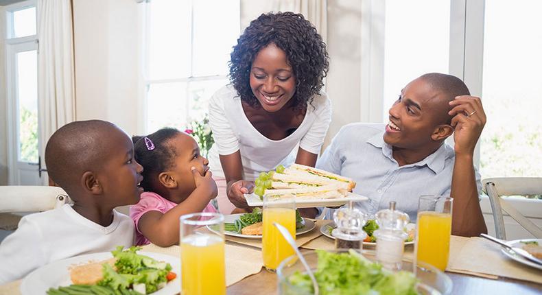 Happy family enjoying meal(orthobridgeorthopedics)