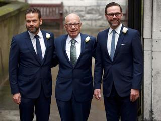 Media Mogul Rupert Murdoch poses for a photograph with his sons Lachlan and James as they arrive at