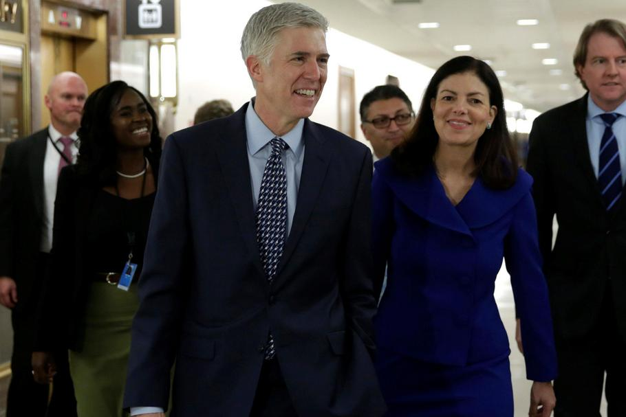 Supreme Court nominee Judge Neil Gorsuch (C) arrives for a meeting with Senator Bob Corker